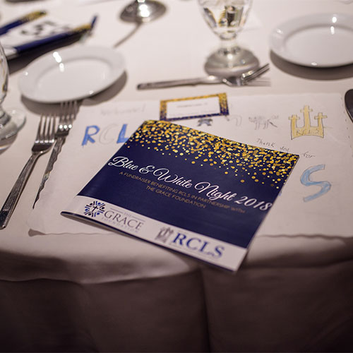 Dining Table with Blue & White Night Pamphlet